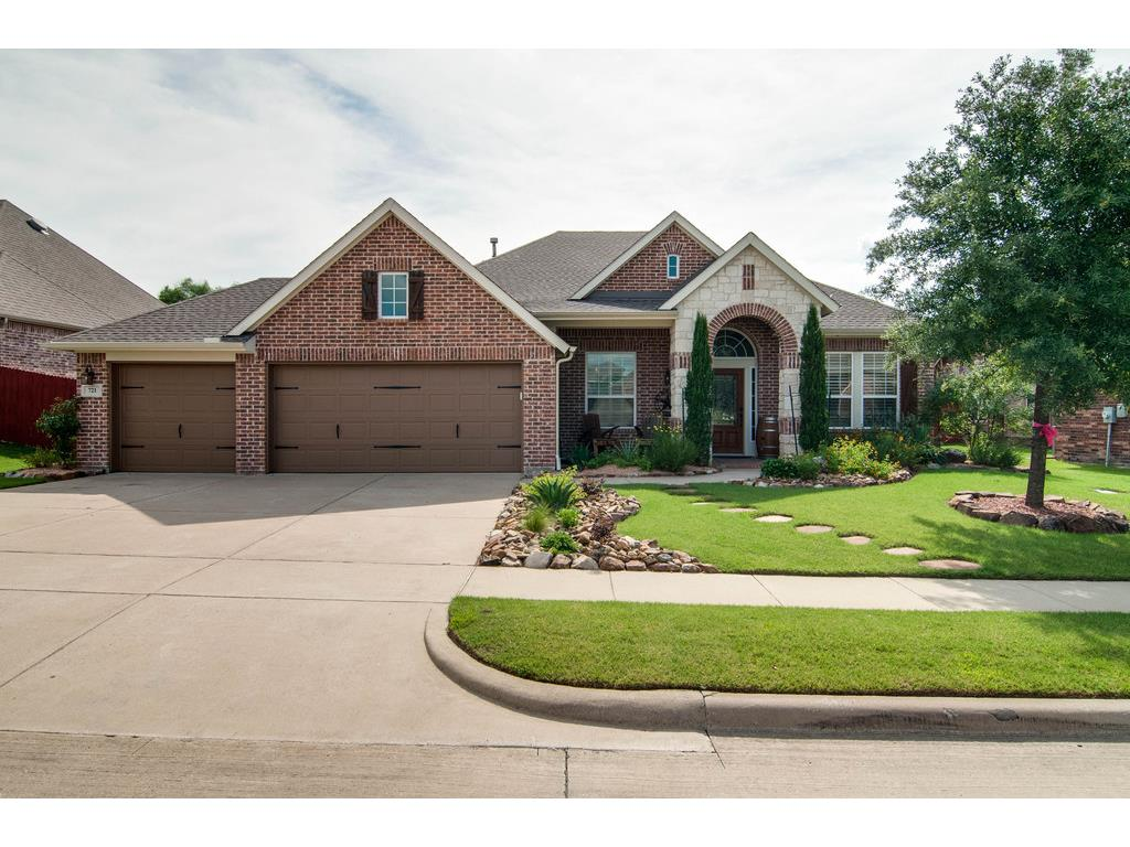 Great curb appeal with professional landscaping, beautiful brick